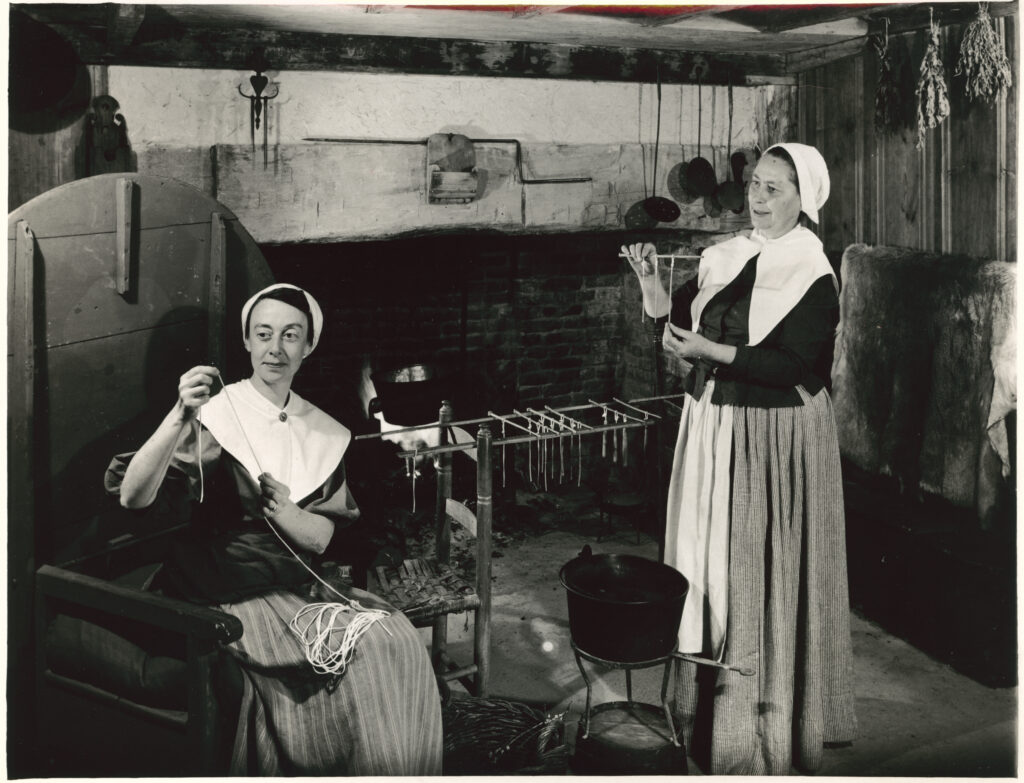 Jane Cooper Baker and Rose T. Briggs make candles in the Harlow House, ca. 1950 (PAS Archives)