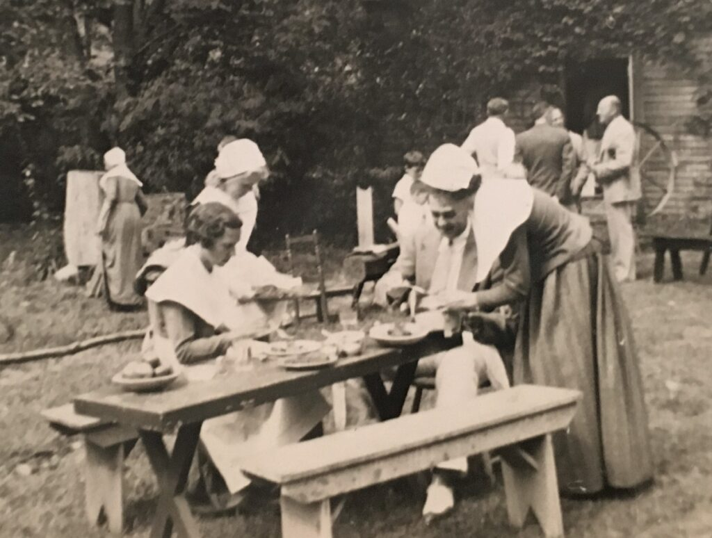 This snapshot shows guests being served on the Harlow House lawn, ca. 1940.