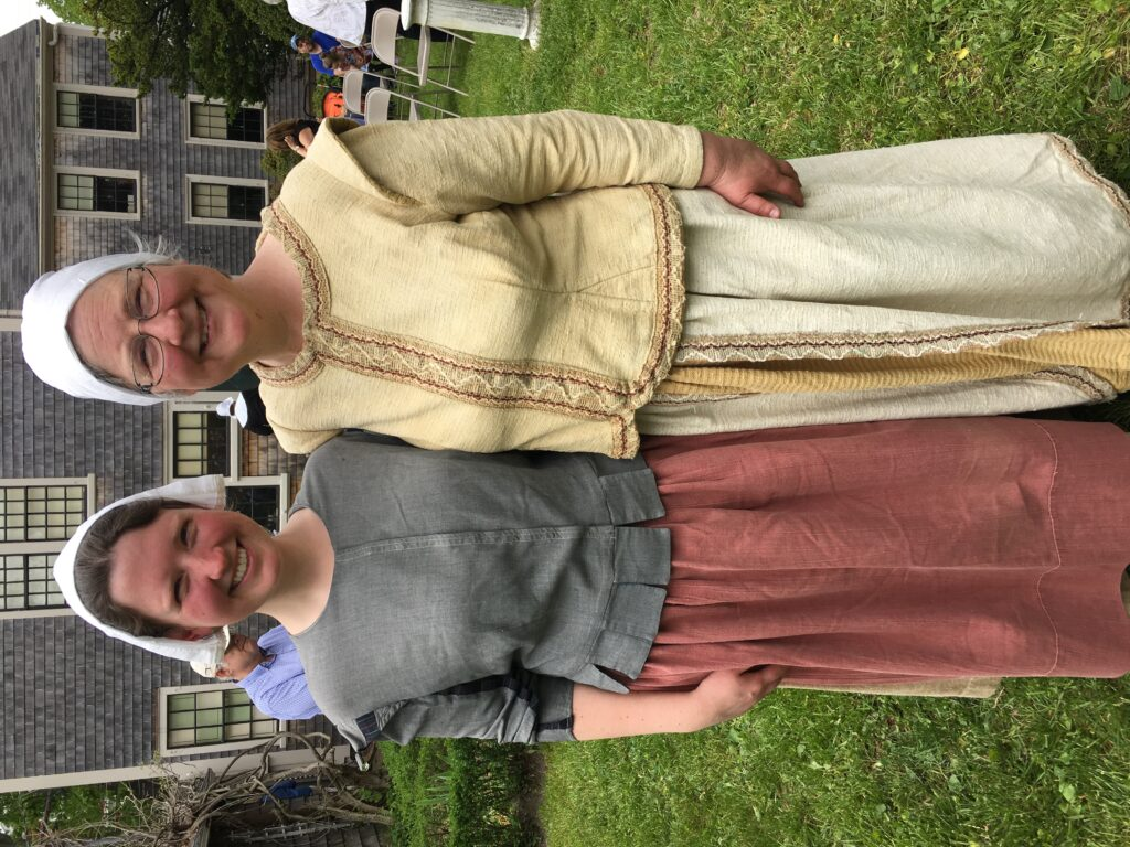 PAS Executive Director Anne Mason and her mother, Elizabeth Reilly, after singing 17th-century tunes at the Spooner House for the annual Pirates Ashore event in 2015. Elizabeth is wearing Joann Doll's costume.